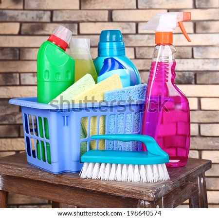 Cleaning products on shelf on bricks wall background - stock photo