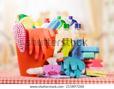 Cleaning products on table and kitchen background - stock photo
