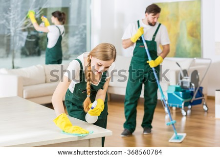 Cleaning service with professional equipment during work - stock photo