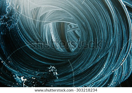 Cleaning set-top stove with cleaning fluid and leaving detergent trails - stock photo