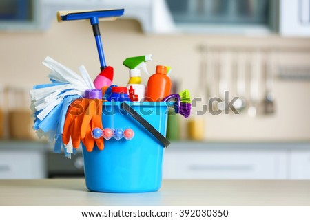 Cleaning set with products and tools in blue bucket - stock photo