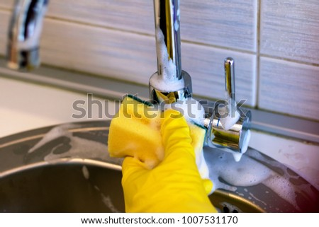 Cleaning sink and faucet close-up. housekeeping and hygiene concept.
