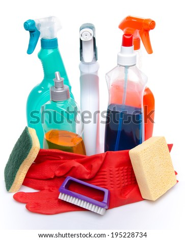 Cleaning spray products with gloves, sponges and a brush, isolated on white