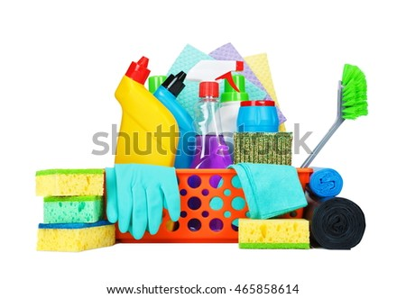Cleaning supplies in a basket - housekeeping concept. Liquid chemical washers, brushes, sponges, latex gloves, glass cleaner and other utensils isolated on white