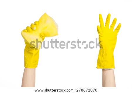 Cleaning the house and sanitation topic: Hand holding a yellow sponge wet with foam isolated on a white background in studio - stock photo