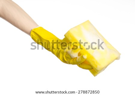 Cleaning the house and sanitation topic: Hand holding a yellow sponge wet with foam isolated on a white background in studio
