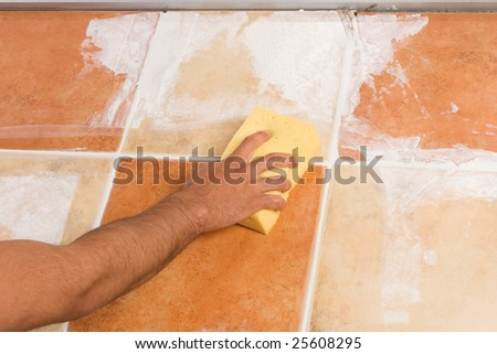 Cleaning the newly installed floor - stock photo