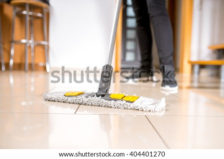 cleaning the tile floor