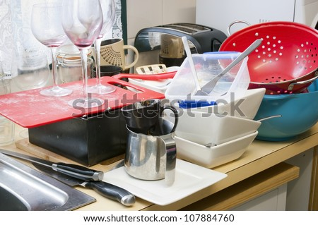 Cleaning up dirty dishes at home on the kitchen sink