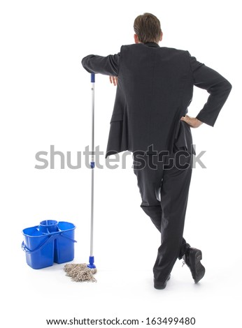 Cleaning up the mess. Businessman with bucket and rag.