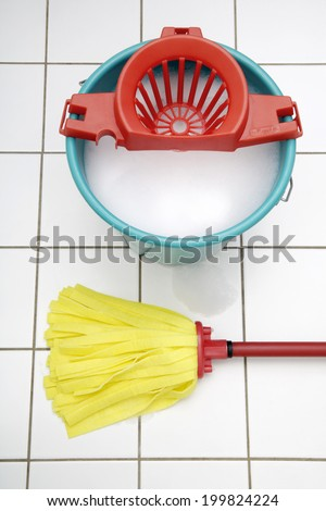 Cleaning utensils, Mop and bucket - stock photo