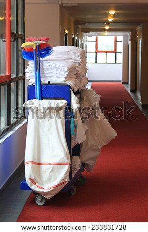Cleaning utility janitorial cart in hotel corridor - stock photo