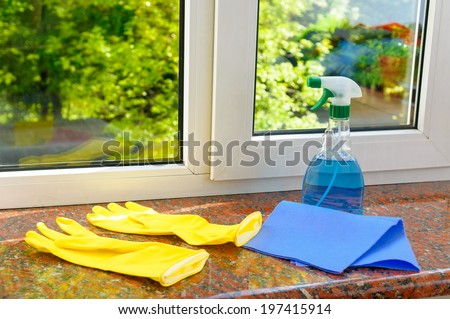 cleaning vinyl plastic window on a background of green trees - stock photo