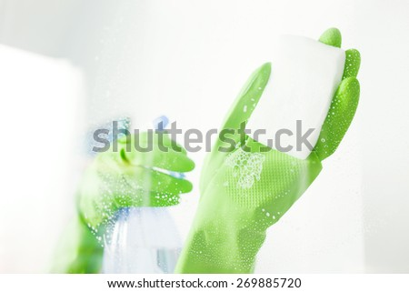Cleaning window pane with detergent, cleaning concept - stock photo