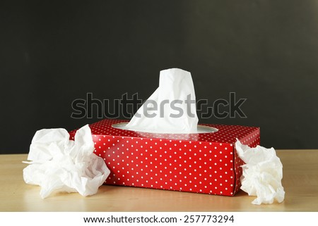 Cleaning wipes on brown wooden background - stock photo