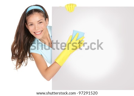 Cleaning woman holding showing billboard sign. Cleaning lady cleaning blank empty billboard paper sign. Cleaning woman wearing yellow rubber gloves smiling happy isolated on white background - stock photo