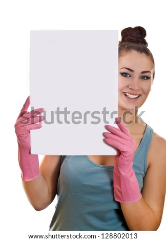 Cleaning woman showing a white paper on the white background