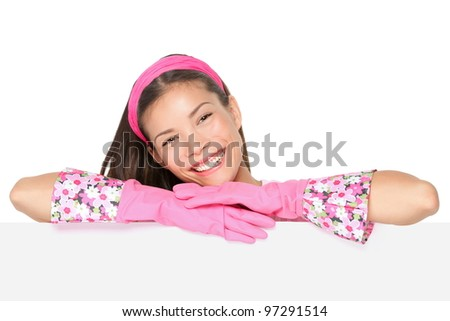 Cleaning woman showing blank sign billboard smiling happy. Spring cleaning concept.  Cute image of cleaning woman wearing pink runbber gloves. Mixed race Caucasian / Chinese Asian female mode - stock photo
