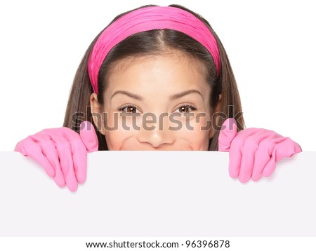 Cleaning woman showing sign. Cleaning lady holding blank paper sign. Cleaning woman in pink rubber gloves smiling happy. Mixed ethnicity Caucasian / Chinese Asian girl isolated on white background. - stock photo
