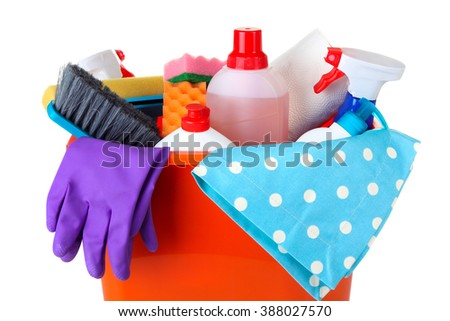 cleanser brush and rubber gloves with sponge wash in a large plastic bucket with a rag on a white isolated background