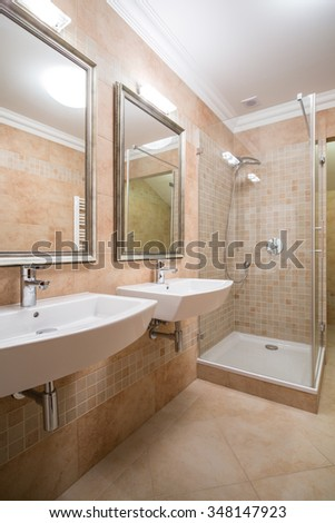 Clear and beige bathroom in the house