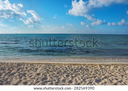 Clear aqua colored water of the Caribbean Sea in Playa Del Carmen off the coast of Mexico. - stock photo