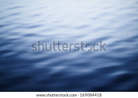 Clear blue sea - abstract background - stock photo