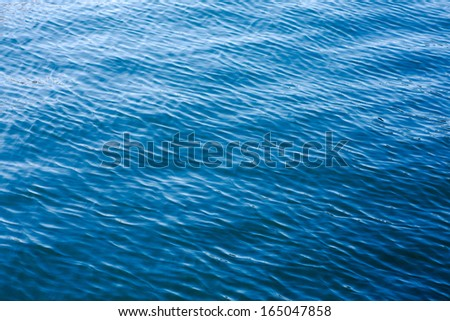 Clear blue sea background. - stock photo