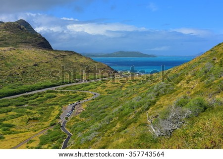 Clear blue sea between the hill ridges at Oahu, Hawaii - stock photo