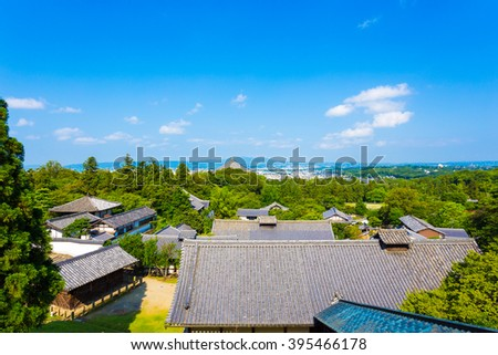 Clear, blue sky morning aerial view of landscape and rooftops from the balcony, deck at Nigatsu-do Hall above the Todai-ji temple complex in Nara, Japan