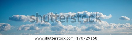 Clear Blue Sky panorama with clouds - stock photo