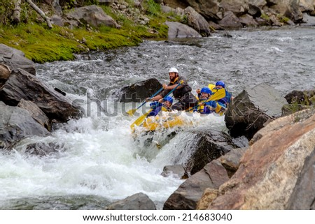 CLEAR CREEK, COLORADO/U.S.A. - August 31, 2014: Late season white water rafting adventure continues on the Clear Creek River just 30 minutes from Denver on August 31, 2014 in Clear Creek, Colorado - stock photo