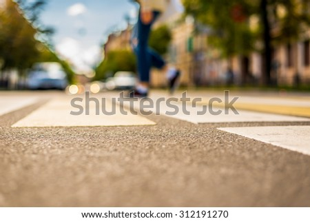 Clear day in the big city, pedestrian crossing the road. View from the pedestrian crossing - stock photo