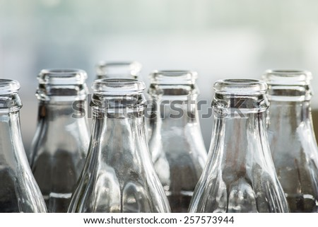 Clear glass bottles in the sun - stock photo