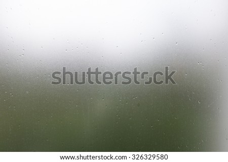 clear glass, water drops splash on transparent mirror window - stock photo