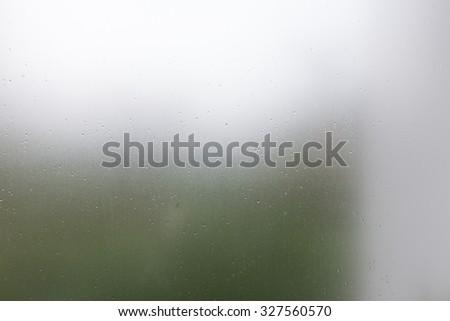 clear glass, water drops splash on transparent mirror window - stock photo