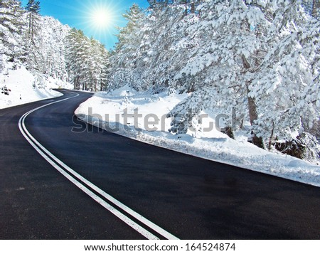 clear road from snow and  sun - transportation - winter weather background  - stock photo