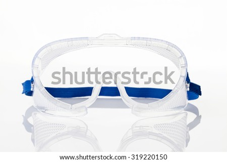 Clear safety glasses against on white background - stock photo