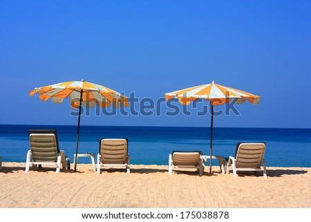 Clear sky beach umbrella - stock photo