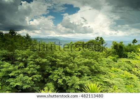Clear sky with plentiful forest and mountain foothills.