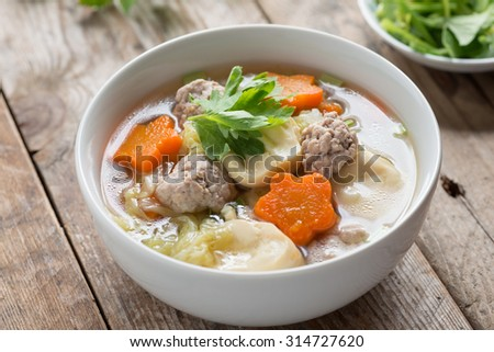 Clear Soup with Vegetables and Meatballs. - stock photo