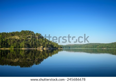 clear surface of the northern lake - stock photo