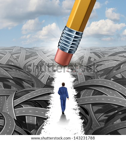 Clear the confusion leadership solutions with a businessman walking through a group of tangled roads opened up by a pencil eraser as a business concept of innovative thinking for financial success. - stock photo