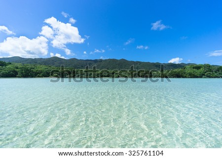 Clear tropical water of a tropical lagoon beach, Ishigaki Island National Park of the Yaeyama Islands, Okinawa, Japan - stock photo