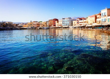clear turqiouse water of Chania habour at sunny day, Crete, Greece, toned - stock photo