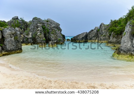 Clear water and pink sand of Jobson Cove Beach in Bermuda. - stock photo