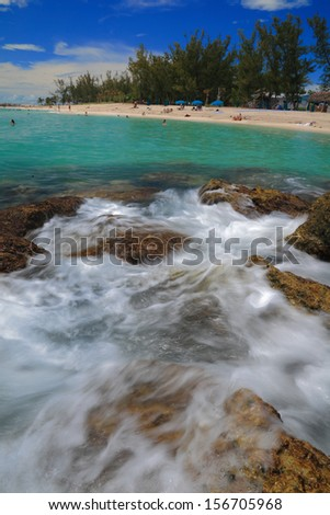 Clear water and white sand beach in daytime  - stock photo