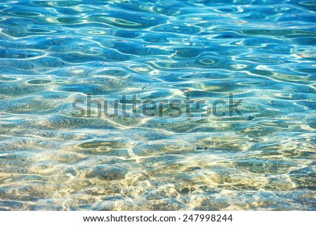 Clear water background, blue natural texture. - stock photo