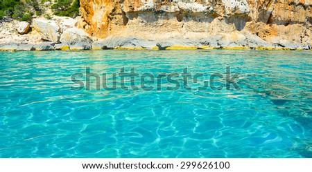 clear water by the shore in Orosei Gulf, Sardinia - stock photo