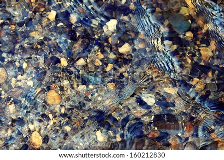 clear water in the river over the texture - stock photo